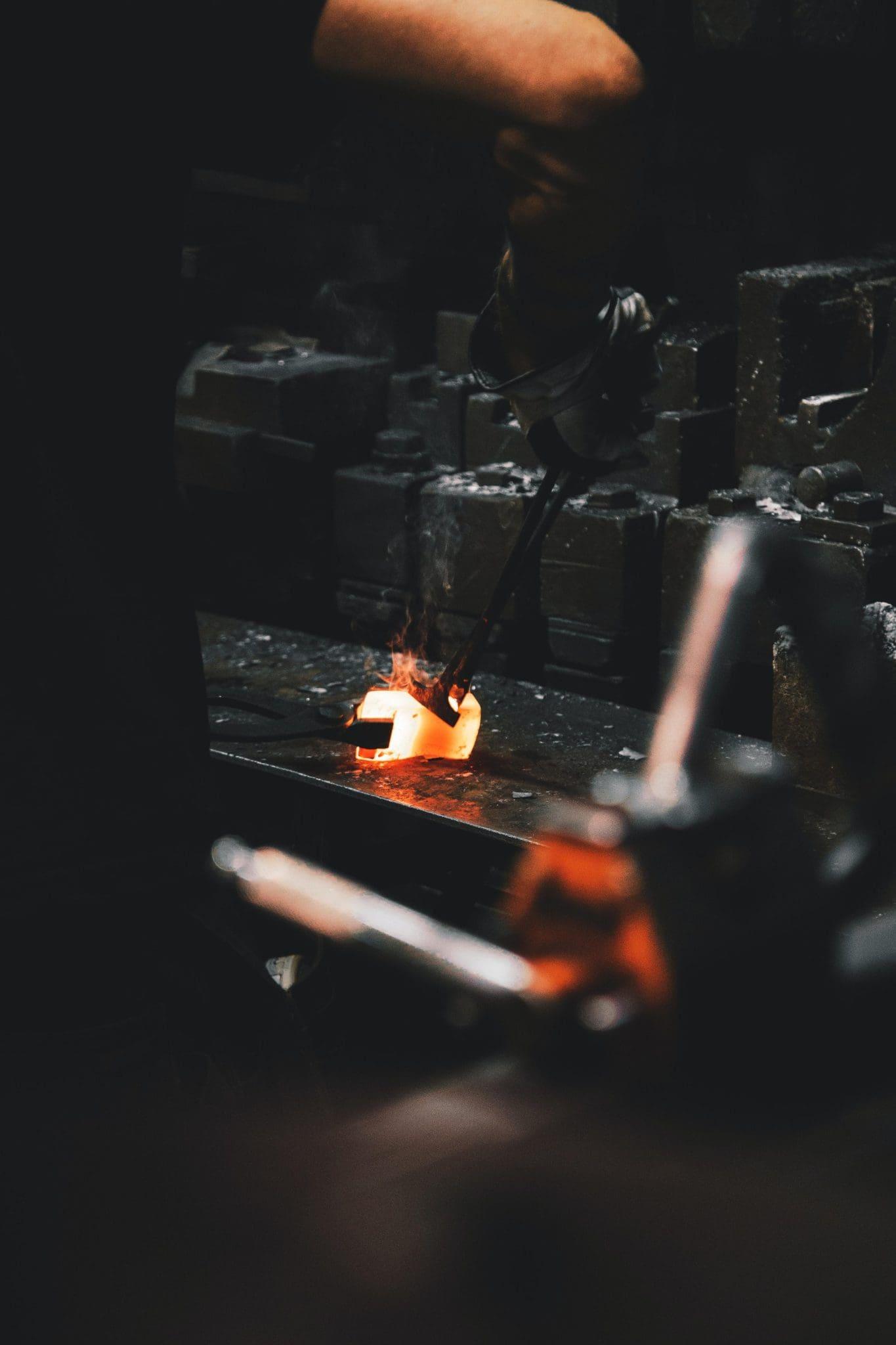 A Metal Worker Repairing Metal Casting Molds